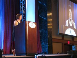 Speaking at Blogher 10 Voices of the Year. In gold shoes. (credit: @teachmama)